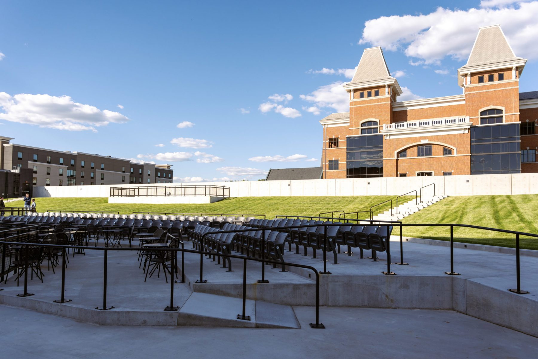 Both permanent and temporary seating are set up in the ampitheater. The Campbell County Courthouse looms large behind the venue. Photo by Phil Armstrong.