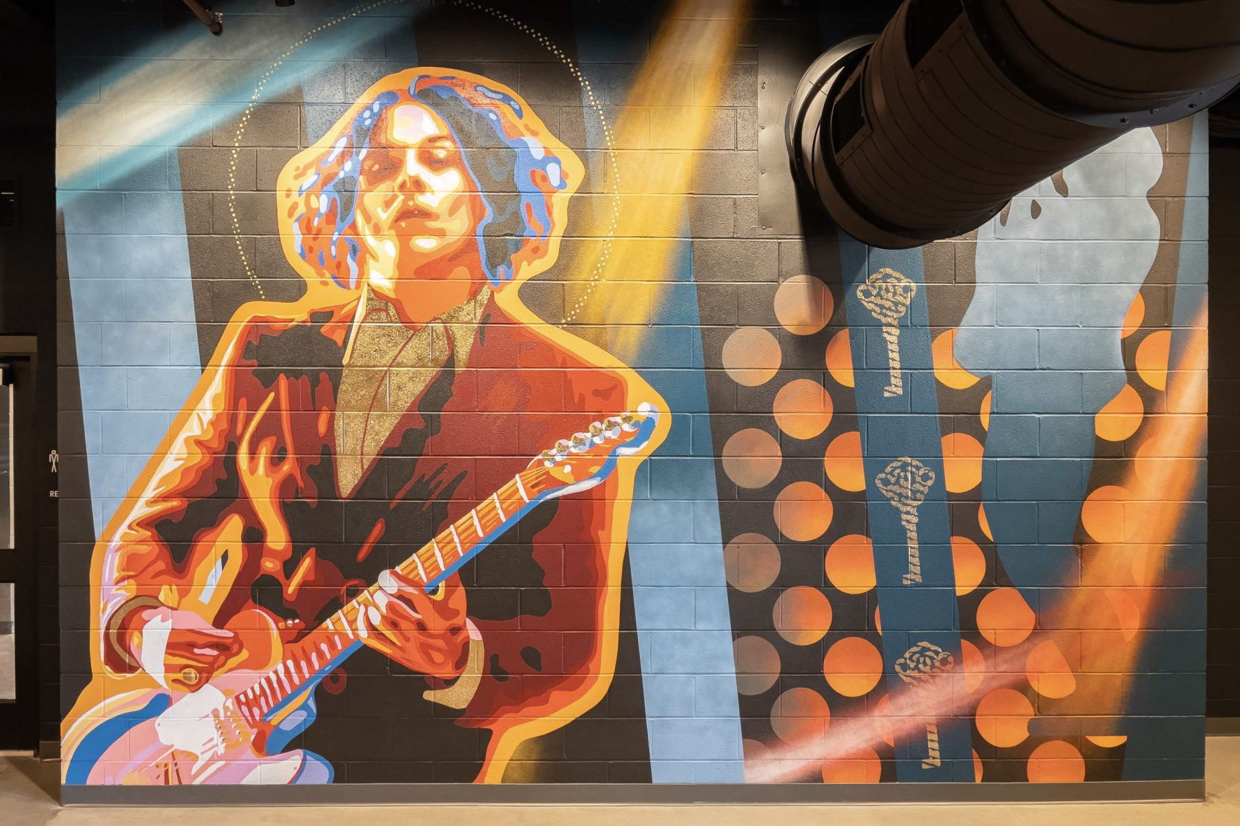 Murals of well-known musicians were painted on the walls of the venue. Photo by Phil Armstrong.